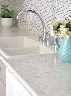 The countertops are Formica Carrara Bianco in the Ideal Edge. It amazes me how far laminate countertops have come! You can get the look of marble for sooooo much less plus they're low maintenance and easy to clean. Formica Kitchen Countertops, Kitchen Countertop Materials, Kitchen Cabinets, White Laminate Countertops, Formica Laminate, White Cabinets, Gray And White Kitchen, White Sink, White Marble