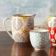 Cute coffee mug and milk pitcher