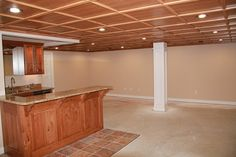 Woodtrac modular ceiling tile - nicer alternative to foam tile? This is great for a basement or a man cave.