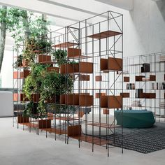 Network double face and selfstanding bookshelf. Each bookshelf can hold max 15 shelves.