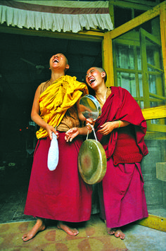 """This photography of Tibetan nuns laughing was a result of serendipitous circumstances. I intended to photograph the nuns announcing lunch with a bang of the gong. When they saw me squat down to take the shot they exploded with laughter, thinking me rather strange to want a photograph of them hitting the gong. As Ansel Adams said, """"Sometimes I do get to places just when God's ready to have somebody click the shutter.""""    The Tibetan Nuns Project http://tnp.org…"""
