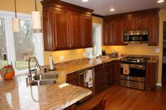 Image result for which granite looks best with cherry cabinets and revere pewter walls