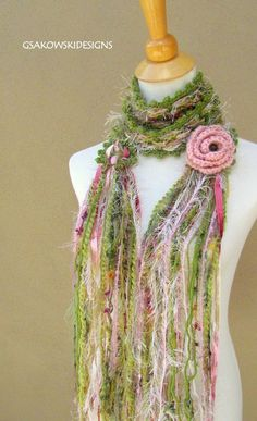 This scarf is a kind of a cross between crochet and weaving. The stitch creates strips on both sides. This scarf is a great piece to add to