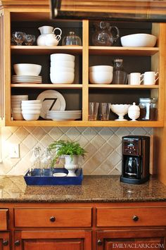 """I like this idea as a cheap """"quick fix"""" for ugly or builder-grade cabinets: Remove the doors and paint the backs dark (contact paper would be more renter-friendly). Trim would update this even further! Have to hide all the """"ugly stuff"""" in other cabinets, but this is pretty cool."""