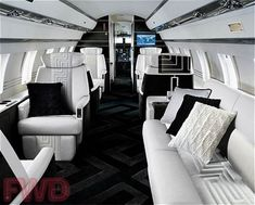 The interior of a really gorgeous private jet, just like the one I envisioned Pound would charter for their tour.