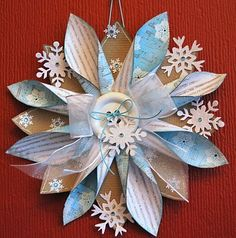 Paper snowflake hanger TUTORIAL- These would be striking on a package.