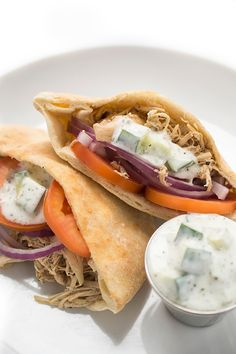 These mouth-watering Slow Cooker Chicken Shawarma Pitas are a healthy alternative to your classic lunch! Top this recipe with a creamy, cucumber yogurt sauce for an extra special taste. keep this Pin handy, because you'll be making this dish again, and again!