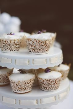Lacy Cupcake Wrappers - So Pretty! See more wedding inspiration on SMP:  http://www.StyleMePretty.com/canada-weddings/ontario/toronto/2014/01/24/lavender-wedding-inspiration-at-weirs-lane-lavender-farm/ Purple Tree Photography