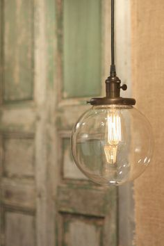 "Hanging Pendant Light Fixture with 8"" Glass Globe Shade and Exposed Socket on Etsy, $168.00"
