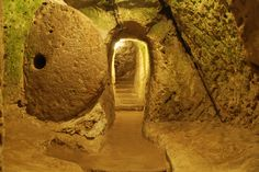 Roll away the stone.  Entrance to Derinkuyu underground city,  Turkey.