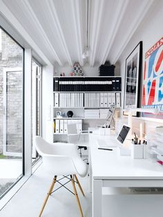 A great studio design for two. Love the bookshelves of binders and books.: