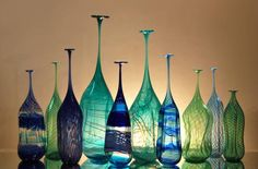 Glass bottles  other cool glass art ideas here: http://storify.com/floeme10/top-4-uses-for-glass-jars