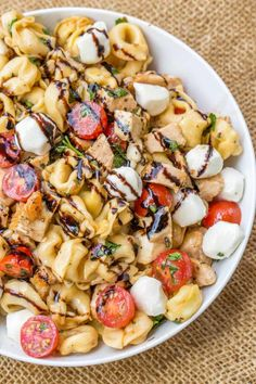 Chicken Caprese Tortellini Pasta Salad is the perfect and quick pasta salad for your summer cookout with chicken, fresh mozzarella, tortellini and quick balsamic dressing.