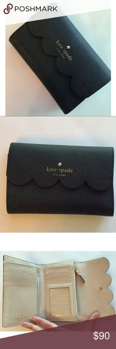 Kate Spade Wallet ♠️ Beautiful scalloped flap lends a playful touch to this lovely black & cream KATE SPADE wallet. ♠️ The cream interior does have a few minor well loved marks. The black exterior has a few worn spots as well.   🎉 Please feel free to make me an offer 💕 kate spade Bags Wallets