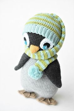 Amigurumi penguin with a crochet wrap around the neck pompom hat. Designed by lilleliis