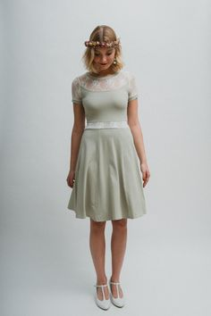 A jersey dress in lime green, with cream colored lace and a wide swinging skirt.  **Size Guide** ...