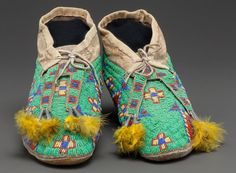 American Indian Art:Beadwork and Quillwork, A PAIR OF SIOUX BEADED HIDE MOCCASINS . c. 1890... (Total: 2 Items)