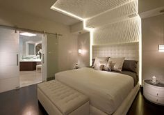 Contemporary opulence: Master Suite bed wall coolness...