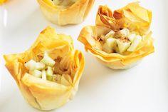 #Apple #custard #tarts : Ingredients      1 small (180g) granny smith apple, peeled, cored, finely chopped     1 teaspoon lemon juice     2 sheets filo pastry     Canola oil cooking spray     1 tablespoon almond meal     1 tablespoon caster sugar     1/4 teaspoon ground cinnamon http://fredsfruit.com/apple-custard-tarts-2/