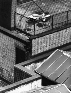 André Kertész Greenwich Village, New York-woman on rooftop reading-1962