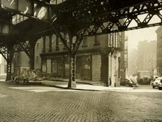 """""""Elevated tracks overhead; Warehouse #2 on triangular lot, corner of New Bowery. 1934-1945.""""(Courtesy of the NYC Municipal Archives)"""