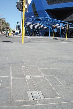 ACO collaborated with the Western Australian based telecommunications company, Amcom, to develop a custom paver infill cover that accommodated Amcom's standard locking method.
