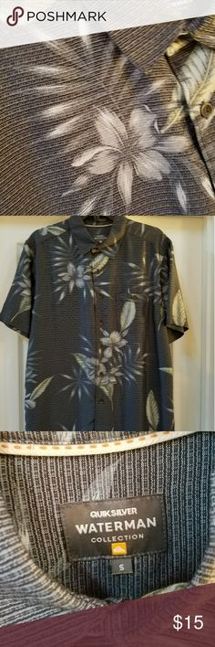 Quicksilver Waterman Short Sleeve Men Shirt Quicksilver incorporated materials meant for the heat in this polynosic fabric. The material is incredibly soft and the subtle hawaiian print will bring the tropical vibes.   Size small, but fits more like a medium.  85% Polynosic, 15% Polyester Quicksilver Shirts Casual Button Down Shirts