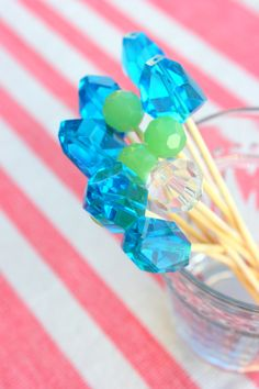 glue beads on top of toothpicks for fancy jewel topped stirrers