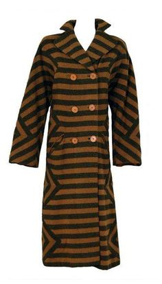 Early 1940's graphic striped coat by Adrian. Mustard-yellow and charcoal-gray color combination. Side diamond-designs.Double-breasted bodice and side-pockets. 1898018_1053542361345490_4154223815126648439_n.jpg (328×576)
