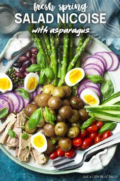 Canned tuna packed in a jar of olive oil and fresh asparagus are featured in my spring nicoise salad! Set it up on a large platter for the best presentation and enjoy all the crisp vegetables, soft boiled eggs, and creamy potatoes all drizzled with a simple lemon dressing. | justalittlebitofbacon.com #saladrecipes #frenchrecipes #springrecipes #spring #salad #frenchfood #asparagus Homemade Chicken And Dumplings, Homemade Pasta, Salat Nicoise, Fig Appetizer, Appetizers, Tuna In Olive Oil, Pork Shoulder Roast, Recipes, Skinny Recipes