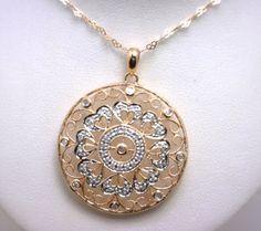 14k rose gold diamond pendant with open filigree design benchmarkgembrokers.com