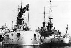 1908: USS Nebraska Battleship BB-14 alongside the USS Wisconsin Battleship BB-9 at the Puget Sound Naval Shipyard, Bremerton, Washington.