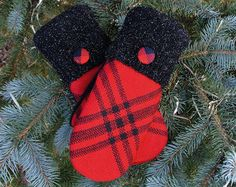 ** Whiskers on Kittens and Warm Woolen Mittens ~ These are a few of my favorite things **  So bright and cheery ~ these mittens are created in a fair isle pattern of brilliant red, ivory, orange & gray. The extra long red cuffs snuggle against your wrist, keeping those nasty cold drafts from sneaking up your sleeve. I added silver buttons to top off these beauties!  The castaway sweaters used in this pair of mittens are of high quality and were hand-picked by myself. Every pair is fully…