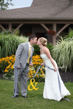Love this pose with the ampersand she had strung between their dinner chairs!