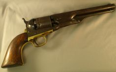 """Colt 1861 Navy Revolver .36cal. 6 shot. 7 1/2"""" barrel. Brass gripstrap. Serial # 14XXX. All original including the wooden grips. Top of barrel stamped: -ADDRESS COL. SAM L COLT NEW-YORK U.S. AMERICA-. Left side stamped .36cal and COLTS PATENT Guns of the Old West"""