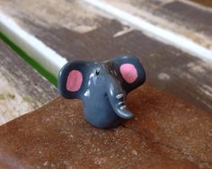 A personal favorite from my Etsy shop https://www.etsy.com/listing/276544210/miniature-polymer-clay-animal-elephant