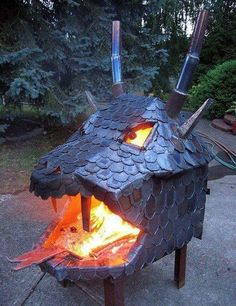 Dragon furnace.  Not quite a kiln but great idea for a fire door to a kiln if you could make the jaw hinge closed.