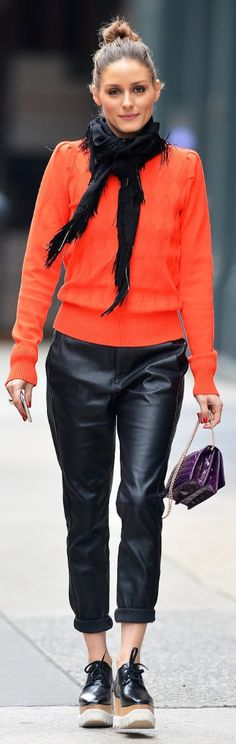 Who made Olivia Palermo's orange diamond print sweater, black platform lace up shoes, and purple handbag?