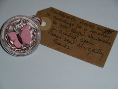 Pillsbury's Pieces No, 185. Pin with pale pink capsule with pink paper butterfly.. In exchange for a donation to KATHMANDU ANIMAL TREATMENT CENTRE, Nepal. Available at St. George's Church, Madrid on Saturday 13 June from 11.00 - 15.00.