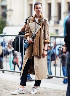 Wear a camel scarf with a trench coat for subtle play on tones.