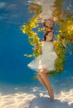 Photo by Elena Kalis.   This is a underwater photo where the girl looks so peaceful. I like the colors in this picture, and her reflection is pretty interesting.