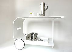 Gorgeous Modern Bar Cart.  Corian and white powder-coated aluminum. FTF Design Studio, Inc.