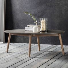 Make a contemporary, raw centrepiece with the Fritz Oval Coffee Table. Made from faux concrete and wood, the clean style gives modern homes a sophisticated edge