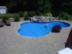One of our favorite backyards in Middleton MA. Lagoon pool with natural rock waterfall and paver pool deck. Swimming Pools Backyard, Pool Landscaping, Above Ground Pool, In Ground Pools, Inground Pool Designs, Lagoon Pool, Swimming Pool Construction, Rock Waterfall, Pool Picture