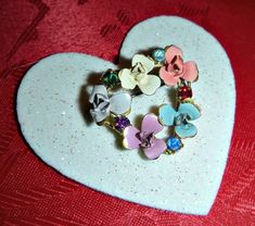 Check out this item in my Etsy shop https://www.etsy.com/ca/listing/493526994/austrian-floral-heart-brooch-pin-forget