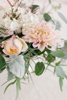 Flowers by Lace and Lilies. Reception / Steamboat Springs, CO - White, Ivory, Blush, Gray, Dusty Green, Sage Green. Soft, Romantic, Timeless, Classic, Elegant. Cocktail Hour, Centerpiece, Marriage, Wedding. Calcynia, Blushing Bride, Eucalyptus, Silver Brunia Berry / Berries, Dusty Miller, Garden Rose, Dahlia, Cafe au Lait Dahlia, Hydrangea