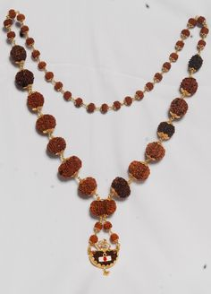 Siddh Malas and indian rudrakshas exquisite and powerful rudraksha Malas, Rudraksha beads are made by combining one bead each of 1 mukhi Gauri Shankar Ganesh Rudraksha 2 mukhi till 14 mukhi Rudraksha of collector variety of highest quality at Indo-Nepal Rudraksha Organization. We can deliver all types of Rudraksha ratna, Rare Rudrakshas & Rudraksha beads at any where in India.