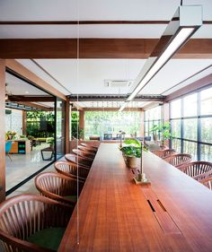 Modern Office Located in Thailand and Decorated in Fresh Dark Green