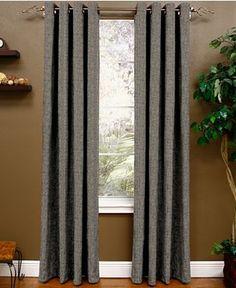 Nice Tweed Looking Curtains With Loud Print Rug.