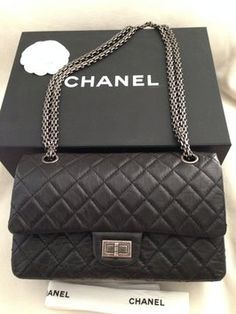 110a484cb943e1 The Chanel Reissue Classic Flap 2013 Vintage Quilted Classic Leather 225  Medium Double Black Calfskin Shoulder Bag is a top 10 member favorite on  Tradesy.